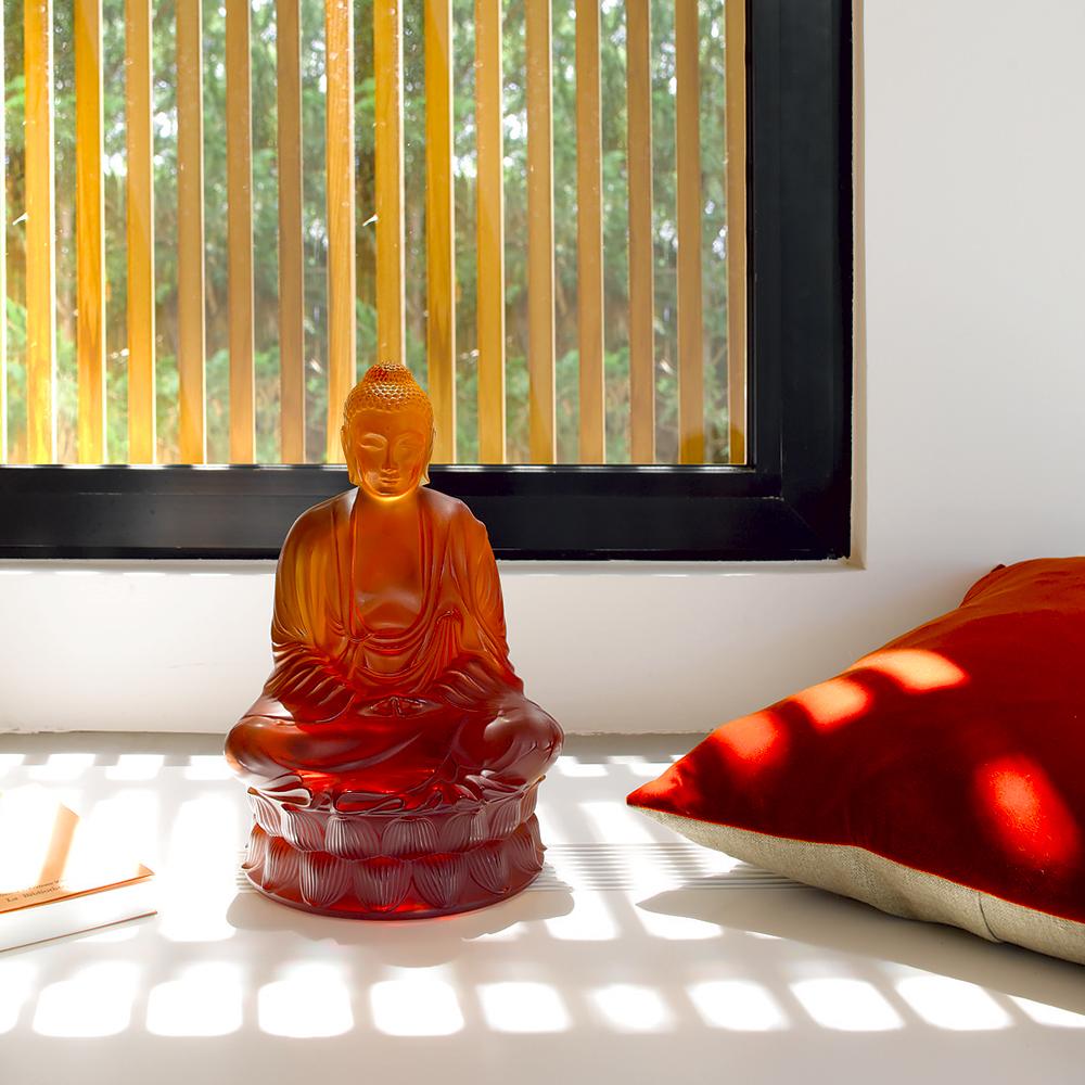 10140300-small-buddha-sculpture1.jpg